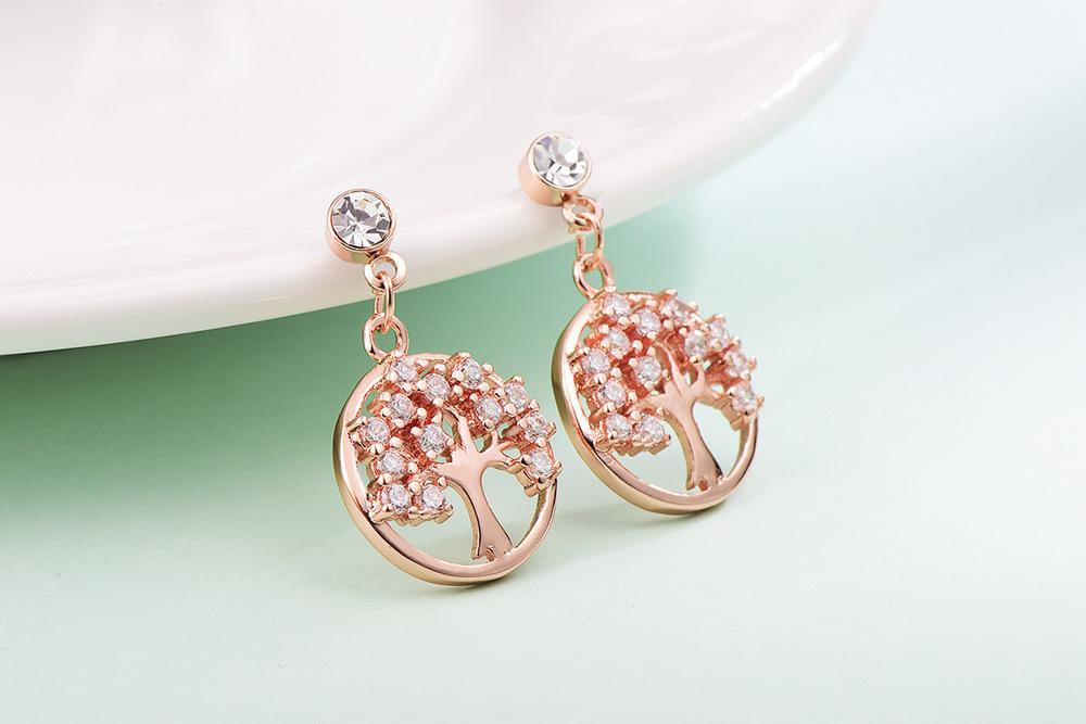 個性時尚鑲鑽小樹 耳針/黏式耳環,桌上展示。